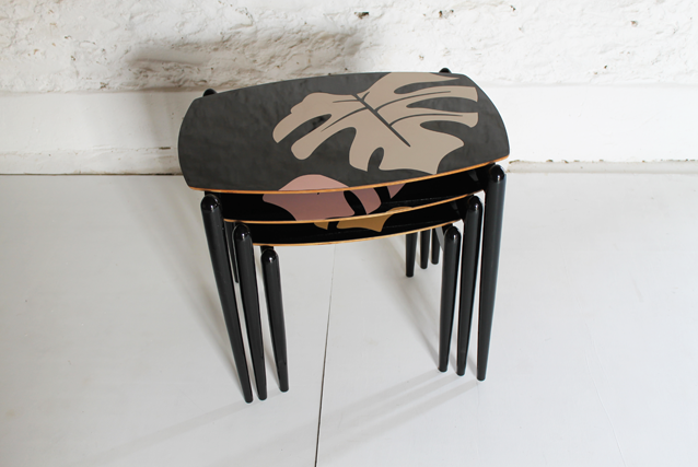 black-glossy-side-tables-tropical-leaf-gold